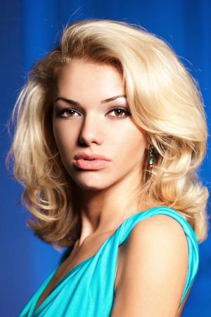 Face of a beautiful young woman. Portrait of fashionable modern girl blonde. photo