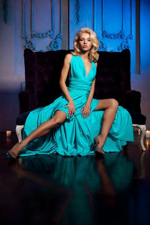 Beautiful woman like a princess in the palace. Luxurious rich fashion stylish girl in a long evening dress. photo