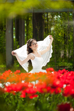 Bride with flowers outdoors photo