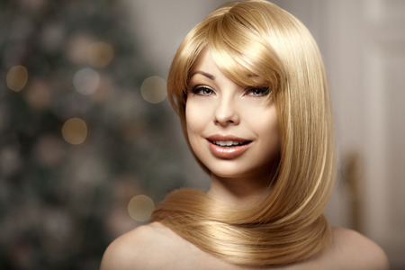 Fashionable trendy young woman with luxurious hair. Beautiful girl with long hair. Blonde with shiny hairstyle. photo