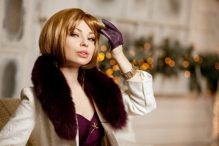 blondy: Beautiful adult woman in a winter coat with fur. Trendy modern blondy girl with short hair Stock Photo