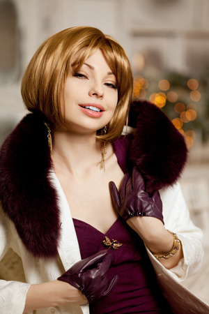 blondy: Beautiful adult woman in  winter coat with fur. Trendy modern blondy girl with short hair