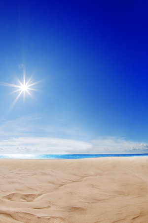 Beach background. Blue sky, the sea, the sun shining. Spa resort. Sand, ocean and rest. Vacation on a paradise island. Tourism. Sunlight. Travel. photo