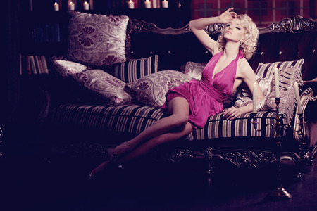 hot girl lying: Young fashionable slim pretty woman in the bedroom.