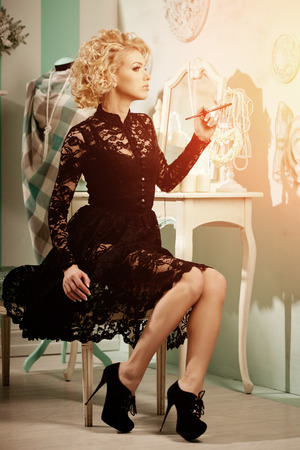 Beauty rich luxury woman like Marilyn Monroe. Beautiful fashionable girl in  retro interior  photo