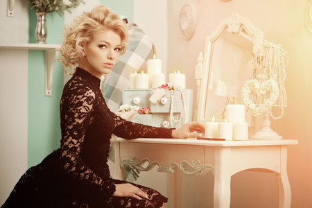 Beauty rich luxury woman like Marilyn Monroe. Beautiful fashionable girl in a retro interior  photo