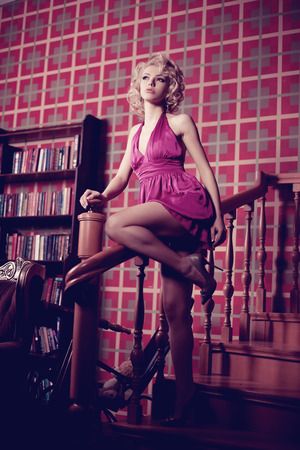 hot house: Luxury woman. Young fashionable slim pretty woman in the bedroom. Blonde in a luxurious interior.