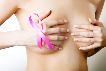breast examination: Breast cancer. Pink ribbon on a womans breasts. Concept of medicine and health care