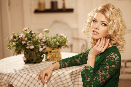 Young beautiful woman in a cafe. Modern trendy blondy girl in restaurant. photo