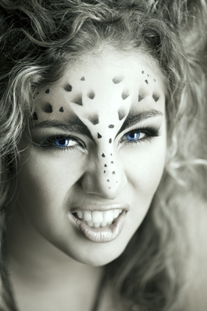 irbis: Beauty woman with makeup in snow leopard style. Fashion makeup model face. Luxury girl with trendy make up
