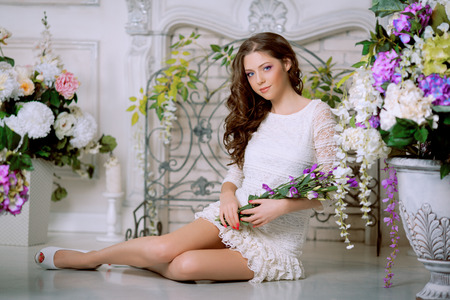 Young spring fashion woman in spring lux vintage interior. Springtime. Trendy girl on a luxury spring background. Allergic to pollen of flowers. Spring allergy