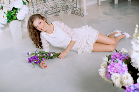 lux: Young spring fashion woman in spring lux vintage interior. Springtime. Trendy girl on a luxury spring background. Allergic to pollen of flowers. Spring allergy