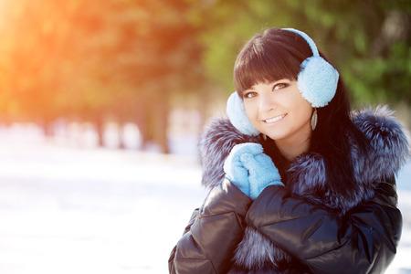 Winter woman on background of winter landscape sun.  Stock Photo