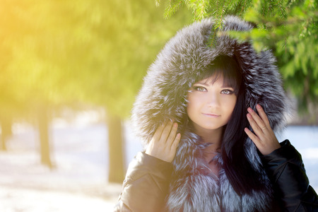 girl in a hat: Winter woman on background of winter landscape sun.  Stock Photo