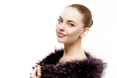 the young animal: Woman in a fur coat.  Stock Photo