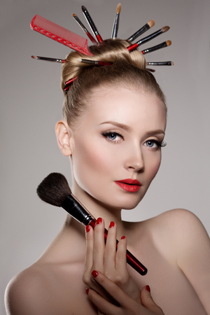 hair dresser: Beauty young girl model stylist with brushes in volume hairstyle.