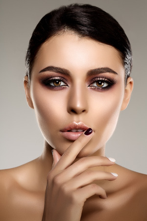 lip: Beautiful model woman in beauty salon makeup