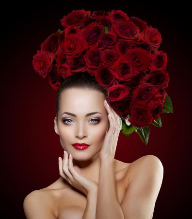red flower: Beautiful model woman rose flower in hair  Stock Photo