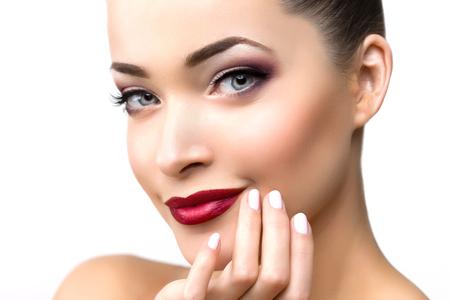 Beautiful model woman in beauty salon makeup