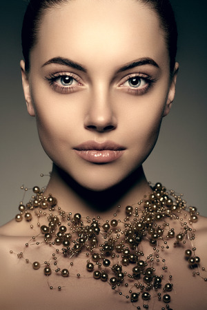 highfashion: High-fashion Model Girl. Beauty Woman high fashion Vogue Style Portrait of beautiful fashionable girl Luxury lady with precious jewelery of pearls around her neck, necklace  Stylish Makeup,  Make up Perfect skin, eyes and lips