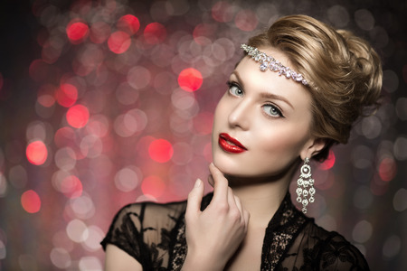 wearing: High-fashion Model Girl Beauty Woman high fashion Vogue Style Portrait beautiful fashionable Luxury lady precious jewelry diamond necklace Stylish Makeup Make up Perfect skin eyes red lips background of blurred lights. Bokeh, backlight