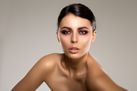 hair and beauty: Beautiful model woman in beauty salon makeup Young modern girl in luxurious spa Lady make up Mascara for long lashes lipstick on lips eye shadow shiny hair manicure with nail polish Products Treatment Stock Photo