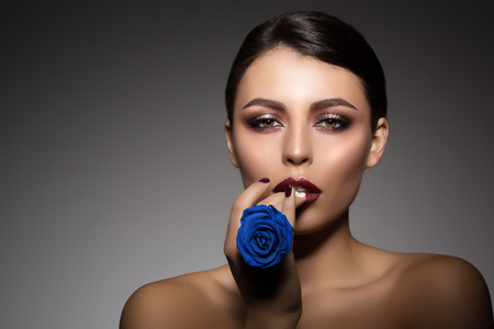 eye makeup: Beautiful model woman in beauty salon makeup Young modern girl in luxurious spa Lady make up Mascara for long lashes lipstick on lips eye shadow shiny hair manicure with nail polish Products Treatment Stock Photo