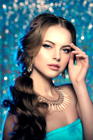 eye makeup: Winter woman model gorgeous beauty makeup stylish hairstyle. Young girl on the background bokeh. Lady make up Mascara for long lashes lipstick on lips eye shadow shiny hair manicure with nail polish Products Treatment Stock Photo