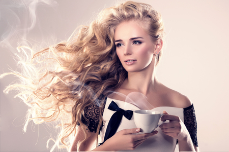 woman shop: Model with coffee cup, mug in coffee shop. Fashion Woman, tea party time. Greem Black. Blonde girl, tea set