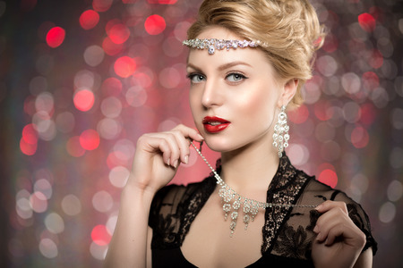 highfashion: High-fashion Model Girl Beauty Woman high fashion Vogue Style Portrait beautiful fashionable Luxury lady precious jewelry diamond necklace Stylish Makeup Make up Perfect skin eyes red lips background of blurred lights. Bokeh, backlight