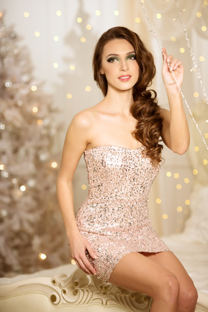 elegant party: Christmans party, winter holidays woman with gift box. New year girl. christmas tree in interior background.