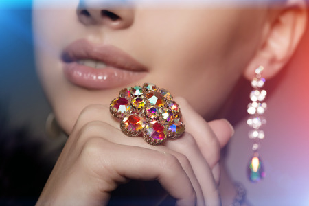 black lady: Jewelry on womans finger and ear close-up Stock Photo