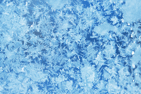 frosted window: Winter ice frost, frozen background. frosted window glass texture. Cold cool icicles background. Winter wonderland scene. Christmas fresh, New Year background Stock Photo