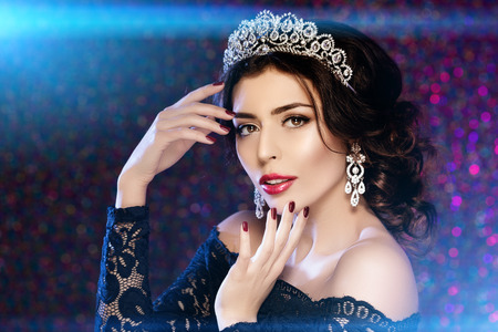 lux: Woman in lux dress and crown on lights party background