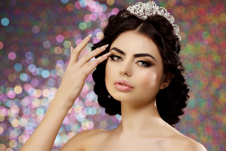 lux: Woman with lux dress and crown on lights party background