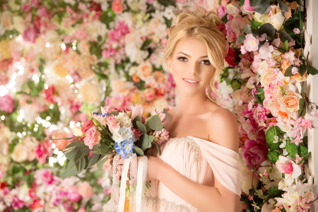 light complexion: Woman with wedding hair and make up on Sweet flowers background.