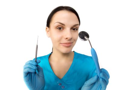 à  à     à  à    à  à female: Dentista con las herramientas. Foto de archivo