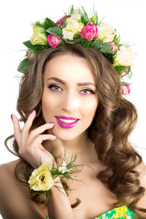 woman hairstyle: Spring woman with flowers wreath and bracelet Stock Photo