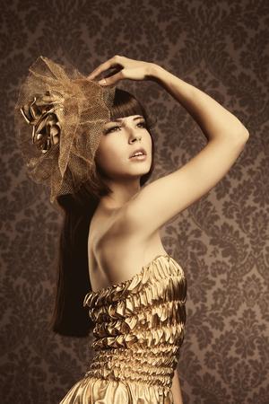 glamorous: Portrait of a beautiful luxurious glamorous model in gold Stock Photo