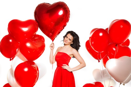 donna innamorata: Beautiful girl, stylish fashion model with balloons in the shape of a heart.