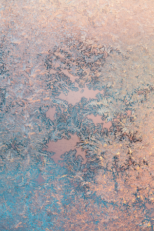 Ice patterns on winter glass. Frost Background