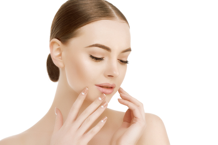 manos limpias: Beautiful woman face close up studio on white Beauty spa model female, clean fresh perfect skin closeup Youth care concept Portrait girl looking at camera, smiling. Cosmetology, manicure nails, hands