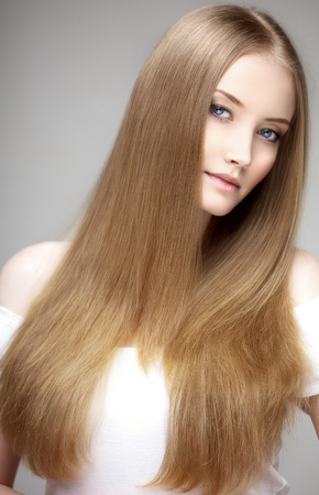 Beautiful model with healthy shiny long hair. Beauty luxurious hairstyle by stylist in salon hair care photo