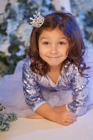 Cute little girl with flowers Banco de Imagens