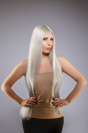 Model blonde with long healthy shiny hair. Woman wearing hair Banco de Imagens