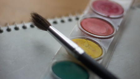 painted brush with red watercolors