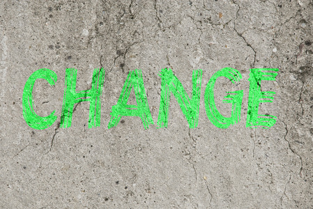 neon green: Neon green word text change on a concrete background