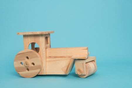 birth announcement: Wooden tractor on a blue background with room for text as a birth announcement card for a boy