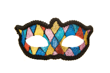 Pretty party carnival mask with different colours isolated on a white background