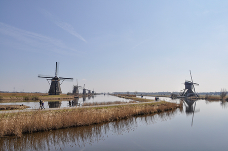 watermanagement: Dutch windmills with a river and blue skye
